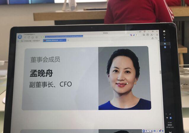 Zdjęcie dyrektor finansowej Huawei Technologies Meng Wanzbou na ekranie komputera