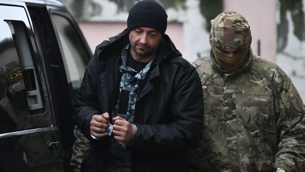 Jeden z zatrzymanych ukraińskich marynarzy przy Kijowskim Sądzie Rejonowym w Symferopolu - Sputnik Polska