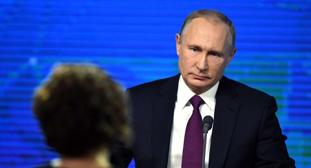 Prezydent Rosji Władimir Putin w czasie corocznej konferencji prasowej w Centrum Handlu Międzynarodowego