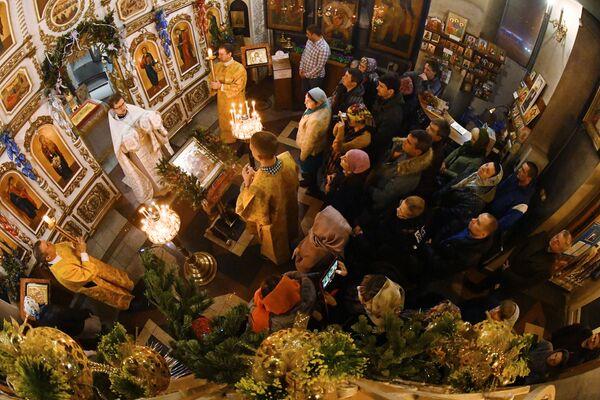Świąteczne nabożeństwo w kościele Andrzeja Apostoła we Władywostoku - Sputnik Polska