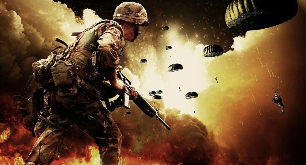 Żołnierz z bronią w rękach podczas desantu na tle wybuchów