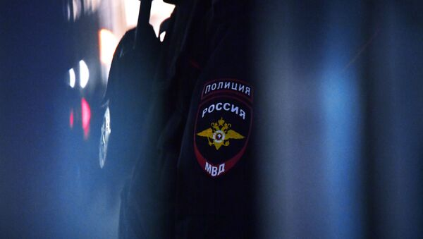 Godło na mundurze pracownika policji - Sputnik Polska